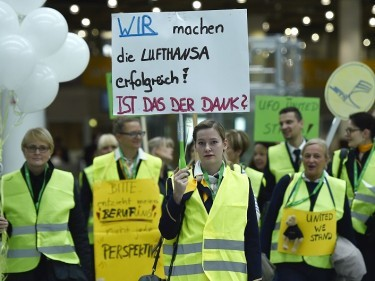 Lufthansa flight attendants protest at the airport in Duesseldorf, Germany (AP)