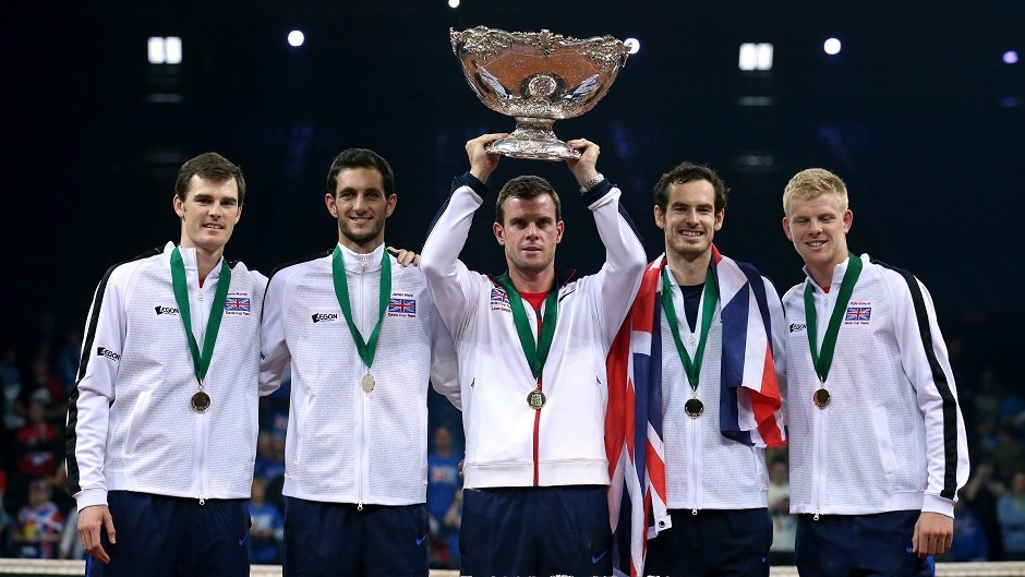 Great Britain's captain Leon Smith lifts the Davis Cup trophy