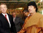 Tony Blair and Colonel Gaddafi shaking hands at Gaddafi's desert base near Sirte in 2007