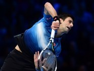 Novak Djokovic won his fourth straight title at the ATP World Tour Finals with victory over Roger Federer