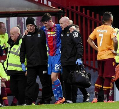 Ryan Christie is helped off the pitch