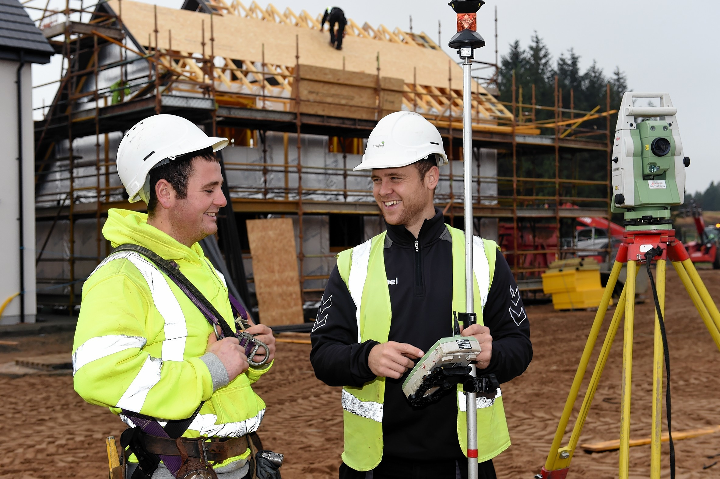 Springfield apprentice scaffolder, Conn Hysert, left, with civil engineer apprentice, Simon Allan, right,  on site at Duncansfield Estate, Elgin.