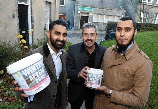 Sumon Hoque (left) and Mamun Razzak with Scott Baxter, Deputy Chief Executive for Aberdeen Cyrenians, launching the Aberdeen Muslims Winter Appeal