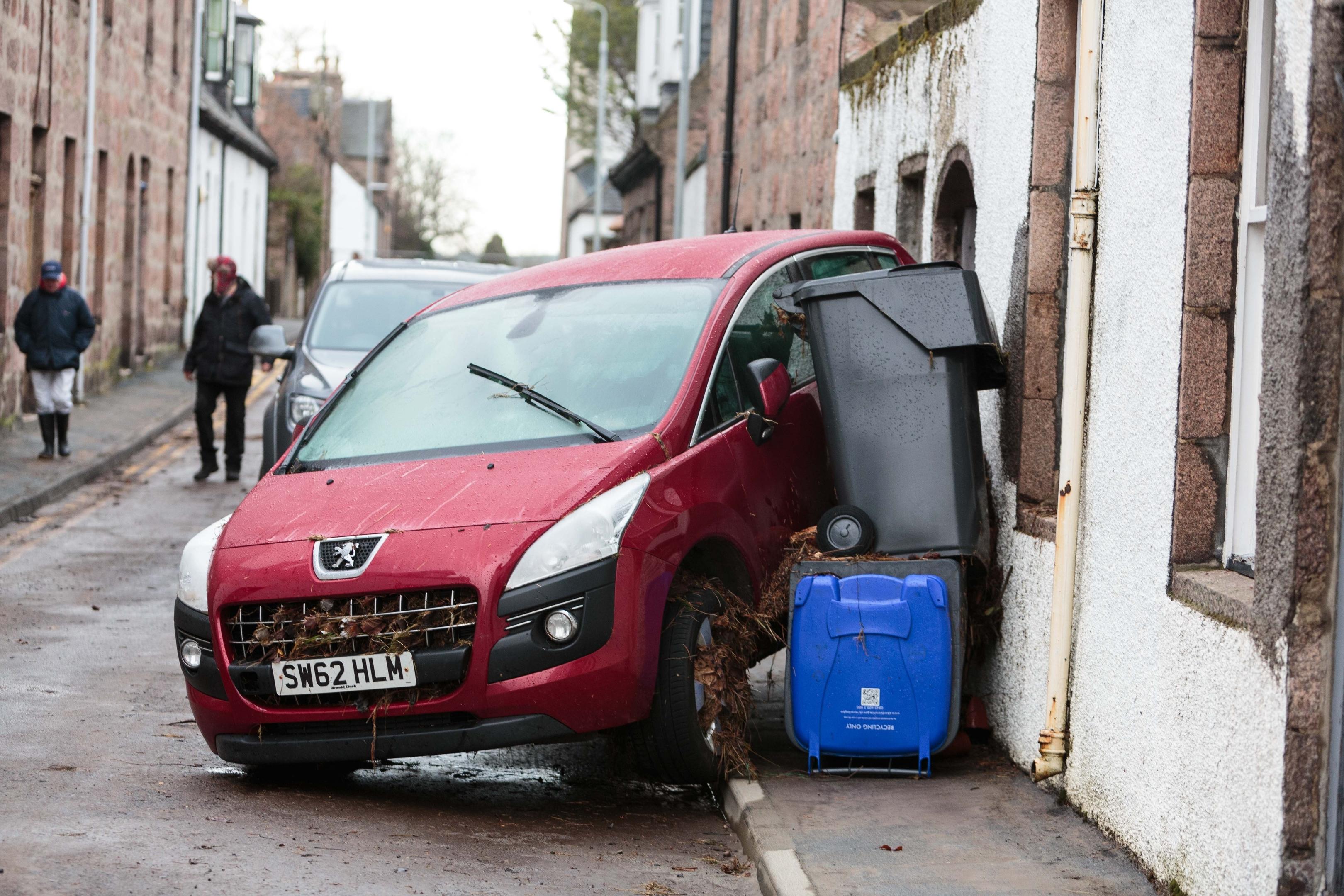 Cars and bins swept away