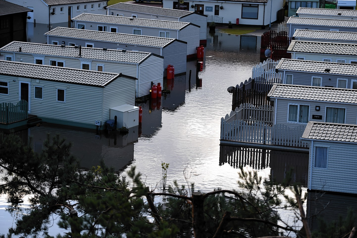 Flooding at the caravan site in Aviemore.Picture by Gordon Lennox 06/12/2015