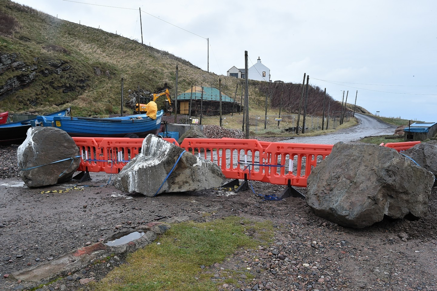 Large boulders and smaller stones arrive at Cove  Harbour to prevent access. Picture by Colin Rennie