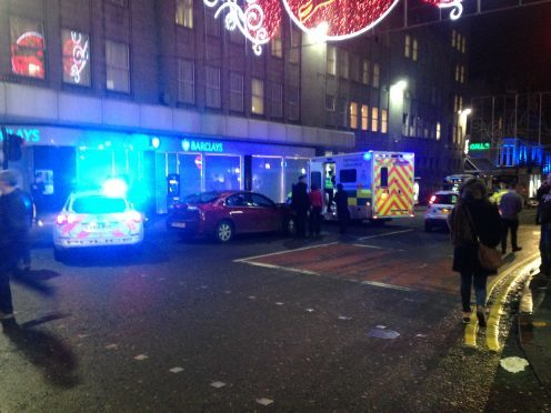 Emergency services are attending to a man who has been struck by a car in Aberdeen city centre