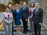 Scotland's political leaders join HIV Scotland chief George Valiotis, centre, to show their support for World Aids Day (Ian Rutherford/HIV Scotland /PA Wire)