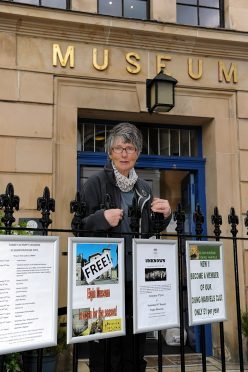 Janet Trythall, vice-president of Moray Society, at the gates of Elgin Museum