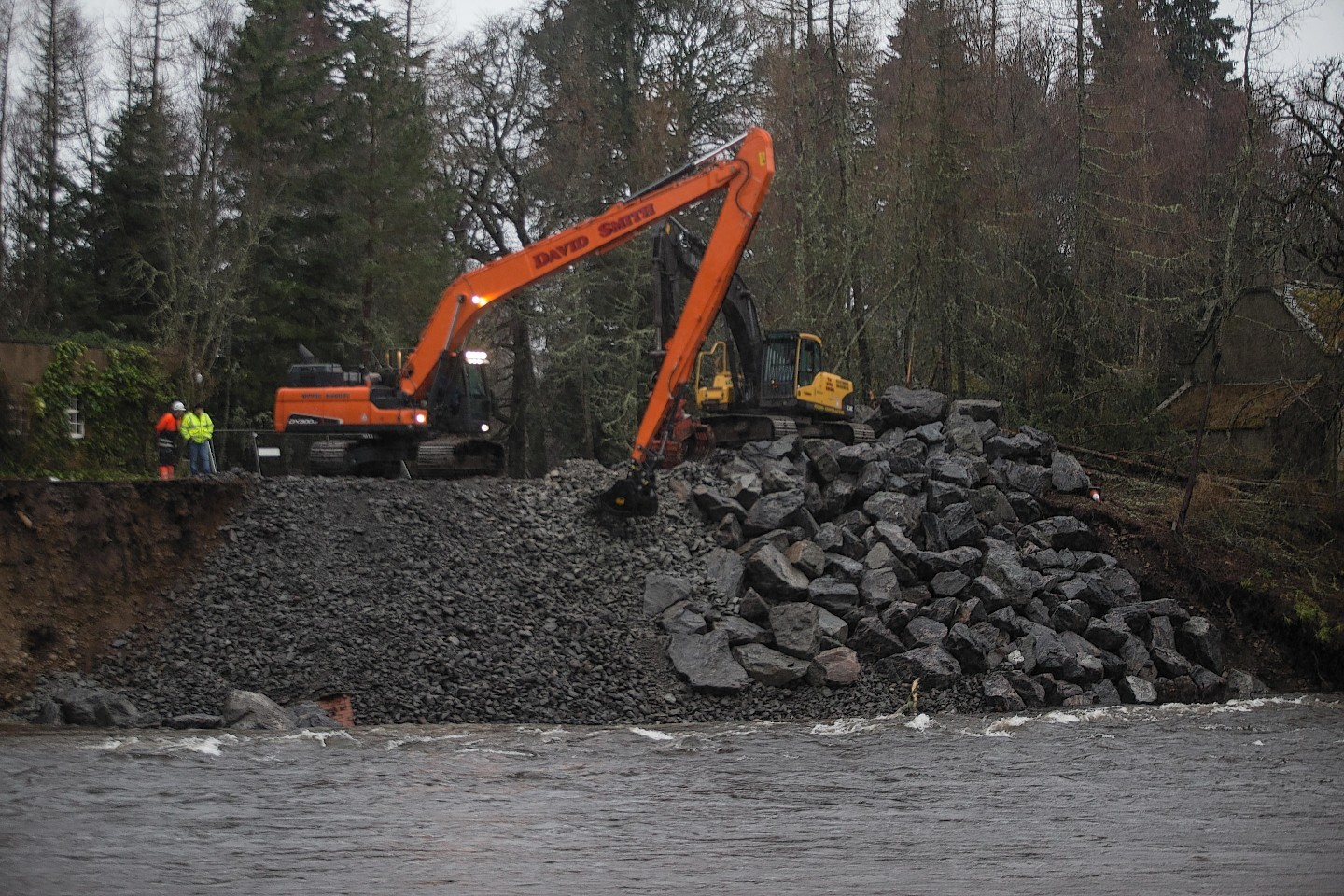 Rocks and boulders added to the riverbank