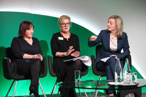 Kerry McCarthy, session chair Charlotte Smith and Liz Truss.