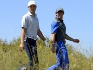 It was round one to Rory McIlroy, right, in Abu Dhabi