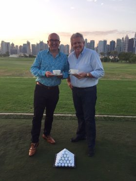 Colin Montgomerie and Aberdeen businessman, David Reid enjoy a cup of tea on the tee in aid of Maggie's