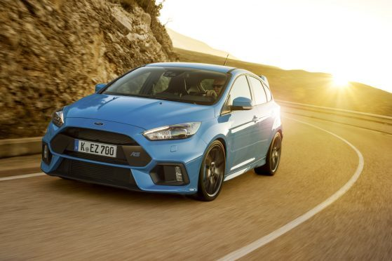 Ford Focus RS 2016 mountain road front sun