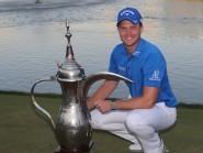 Danny Willett poses with his Dubai Desert Classic trophy (AP)