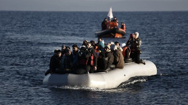 Refugees and migrants arrive on a dinghy from the Turkish coast to the Greek island of Lesbos (AP)
