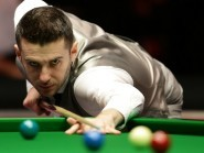Mark Selby, pictured, suffered a 5-3 defeat to Stephen Maguire in Berlin