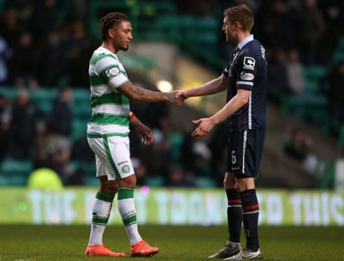 Ross County's Chris Robertson shakes hands with Celtic's Colin Kazim-Richards