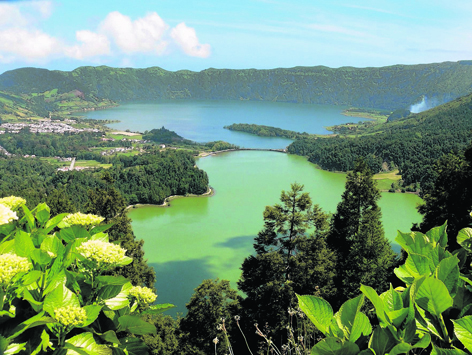 At Sete Cidades on Sao Miguel, two adjoining lakes, one blue, the other green...