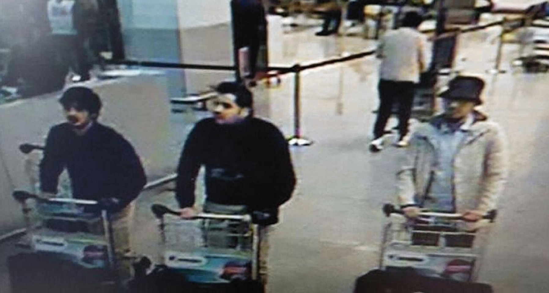 A CCTV image of three men said to be suspected of being behind the airport attacks