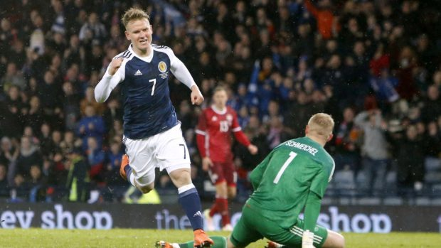 Scotland's Matt Ritchie, left, celebrates scoring against Denmark
