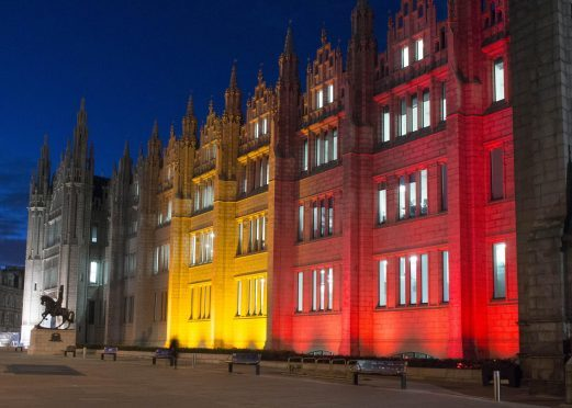 Marischal College lit up with the colours of Belgium flag. (Picture: Norman Adams, Aberdeen City Council)