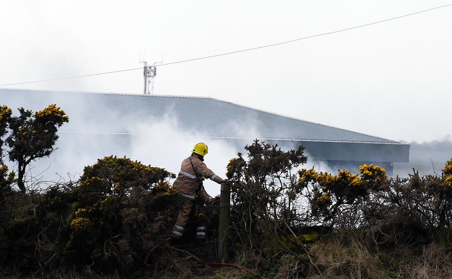 Fire crews attend the blaze at a unit in Blackhill Industrial Estate. Picture by Kami Thomson