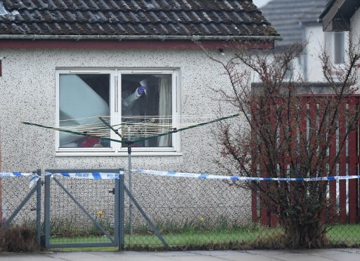 Forensic officers at work in the home of Elizabeth Mackay in Kintail Court, Inverness
