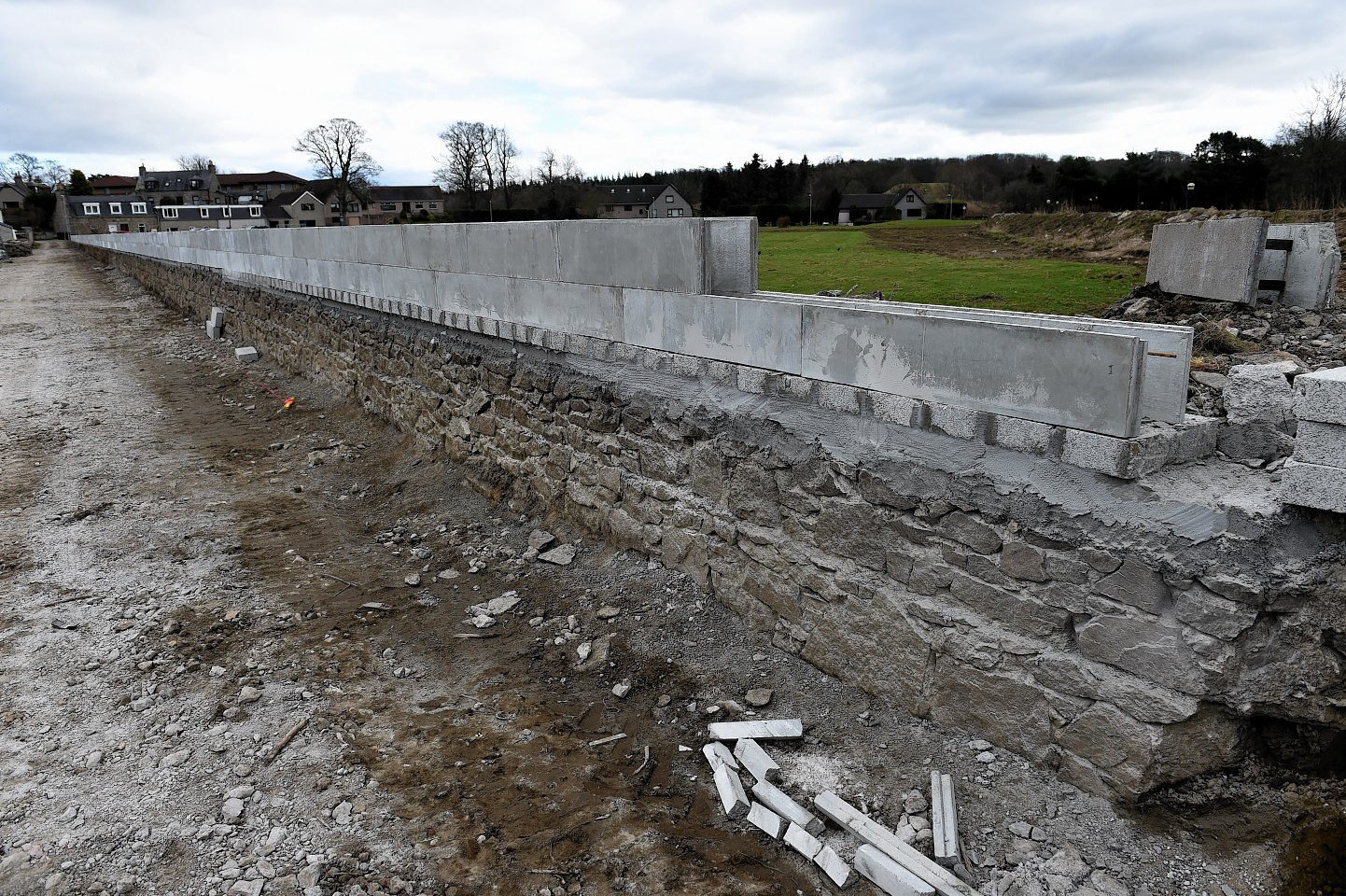 The firm is building a flood defence behind their business to help protect against future flooding.