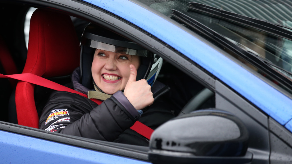 Scottish Conservative leader Ruth Davidson sits in a blue car at Knockhill racing circuit near Dunfermline in Scotland, while on the her election campaign trail. She drove around the track racing a red car.