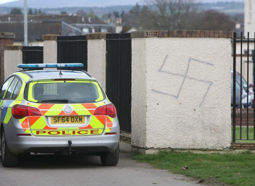 Swastikas have been painted on walls and garage doors in the Muirtown Basin area of Inverness. Picture by Andrew Smith