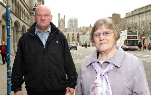 Kevin Watt with his mother outside Aberdeen Court. Joyce was stalked by Mark Mickowski.