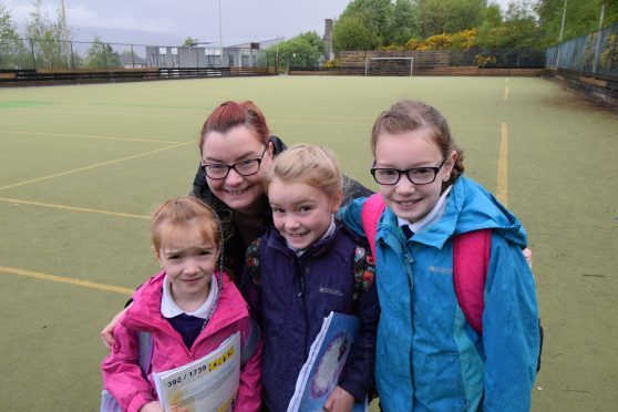 Wendy Lev with her daughters (left to right) Lana, Maya, and Adi at Upper Achintore astro pitch when they launched the petition to save it