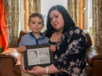 Leah Whyte with her son Yusuf and photos of Iysa