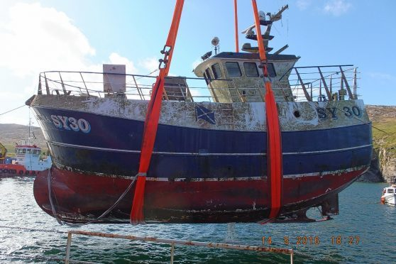 The MV Louisa is raised from the seabed
