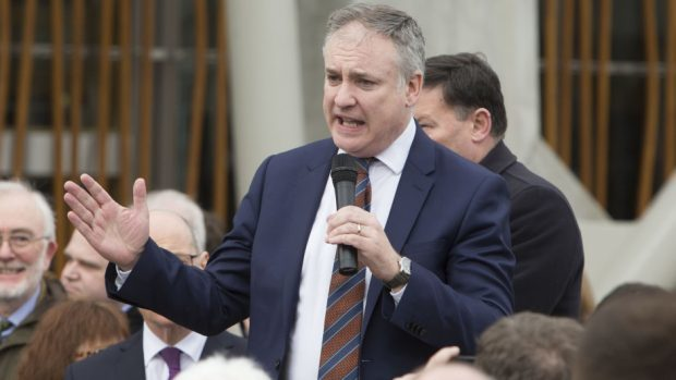 Former rural affairs secretary Richard Lochhead addresses a NFU Scotland protest rally