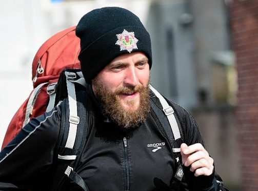 Wayne Russell is running the entire coast of Britain for charity.