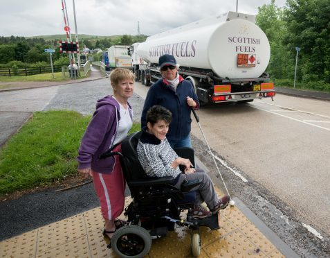 Jan MacLugash (left) with her daughter Tina and friend Annette Hobson attempting to cross the A830 near Banavie swing bridge
