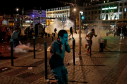 People run after police fired tear gas following clashes after the Euro 2016 soccer championship group B match between England and Russia in Marseille, France