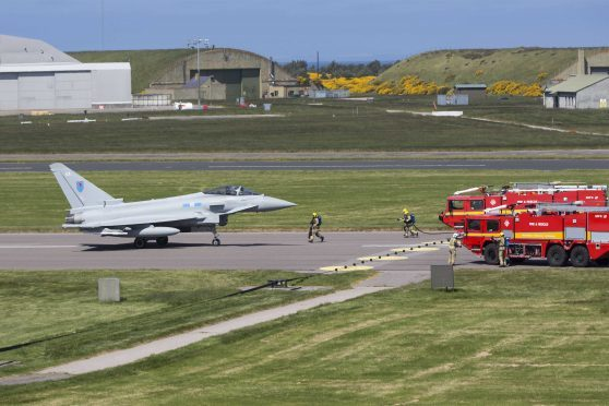 The Typhoon jet was met by fire engines after it landed at Kinloss.