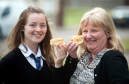 Grace Wakeford,13, is having her recipe for  scones used at Ashers Bakery in Lossiemouth with Margaret Davidson, from Ashers.