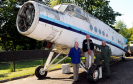 Bob Dunnett, director, Alistair Mackie, volunteer, and Bob Pountney, director, Morayvia Aerospace Centre, beside the fuselage of the Antonov AN-2, of which they recently took delivery.