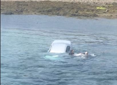 Stuart McIvor took to the water to save the driver. Pictures and video by Airpro Media