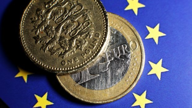 The financial shockwaves of the Brexit vote have begun to reverberate as the outlook on Britain's credit rating was downgraded