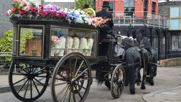Peggy Mitchell's funeral procession in Albert Square (BBC/PA)