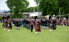 The massed pipe bands being led by Bert Summers,  Turriff drum major