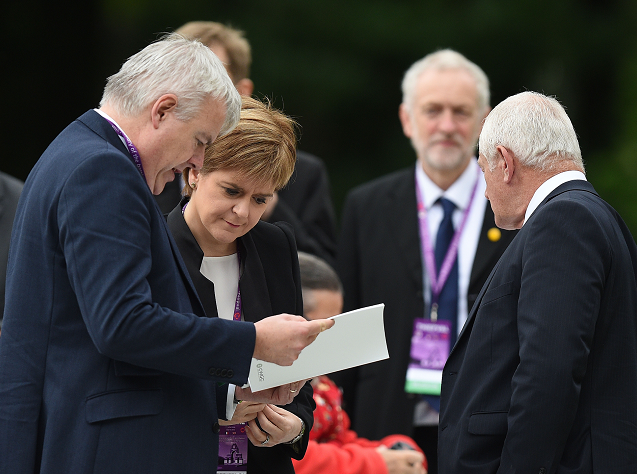 Nicola Sturgeon stands with Carwyn Jones as they wait to take their seats at the Commemoration of the Centenary of the Battle of the Somme at the Commonwealth War Graves Commission Thiepval Memorial