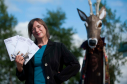 Findhorn Bay Festival director Kresanna Aigner at the launch of festival's programme with the events mascot, Struan the Stag.