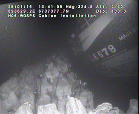 Underwater image showing sandbags against the wreck of Majestic