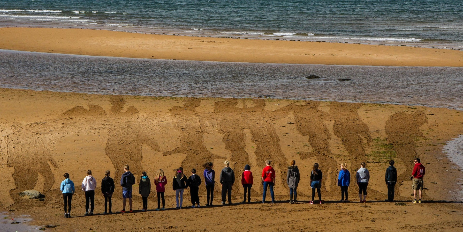 """Sand drawing """"Somme Soldiers"""" by Sand In Their Eye, on the beach in Elie, Fife"""